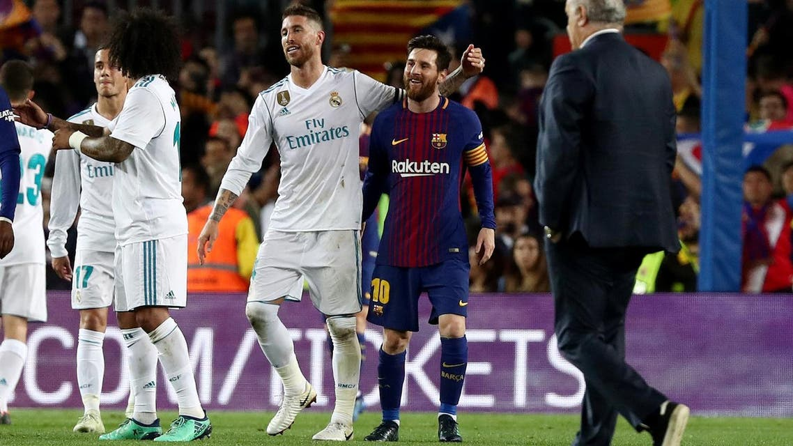 Barcelona's Lionel Messi with Real Madrid's Sergio Ramos at the end of the match. (Reuters)