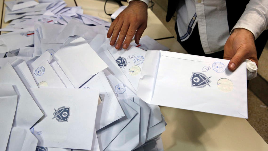 An election official counts ballots shortly after the polling stations closed, in Beirut, Lebanon, Sunday, May 6, 2018. (AP)