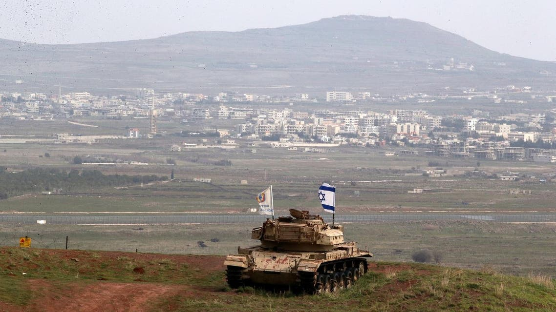 An old military vehicle can be seen positioned on the Israeli side of the border with Syria. (Reuters)