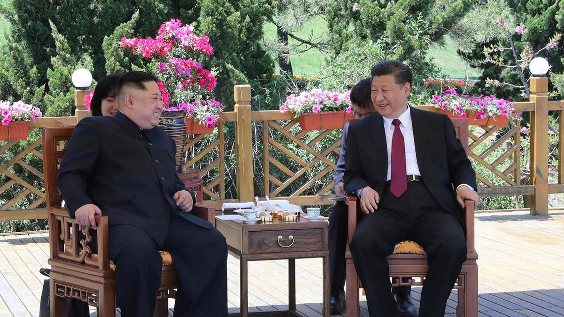 Chinese President Xi Jinping, right speaks to North Korean leader Kim Jong Un in Dalian in northeastern China's Liaoning Province. (AP)