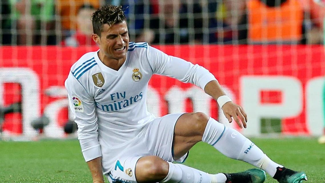 Real Madrid's Cristiano Ronaldo goes down after sustaining an injury. (Reuters)