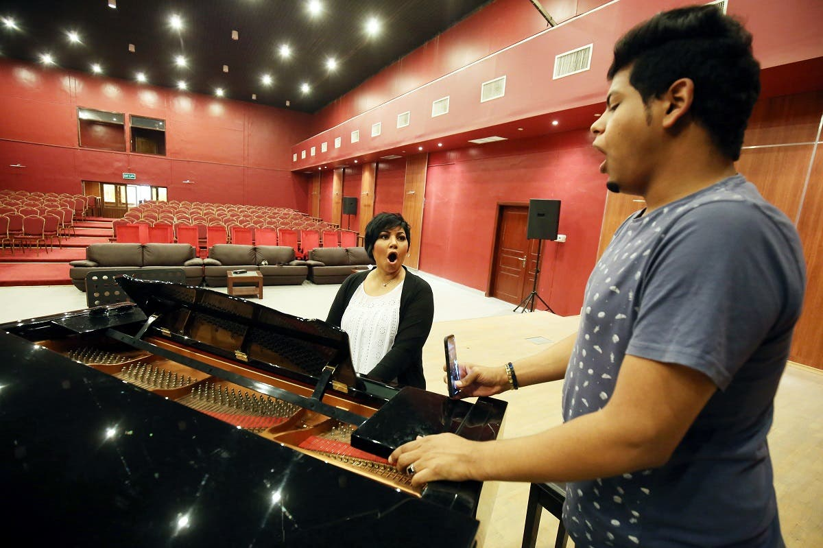 Kuwaiti opera singer Amani Hajji (L), sings with one of her students at the Higher Institute for Musical Arts in Kuwait City. (AFP)