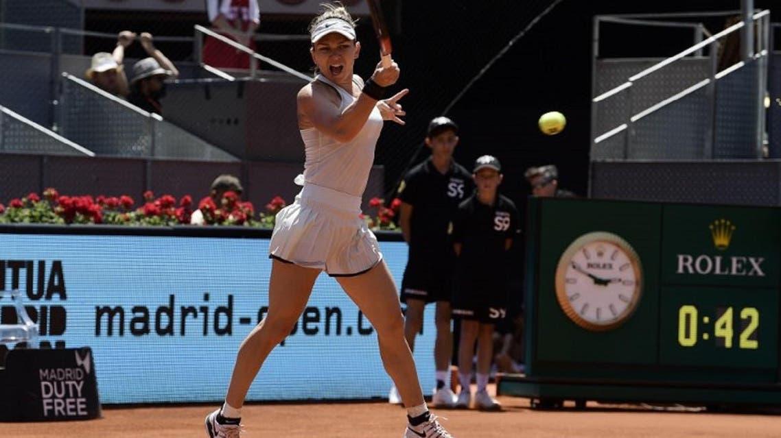 Simona Halep returns the ball to Karolina Pliskova during their WTA Madrid Open quarter-final tennis match at the Caja Magica in Madrid on May 10, 2018. (AFP)