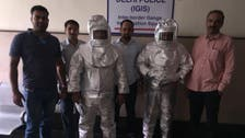 'Space suit' scammers father-son duo paraded in India
