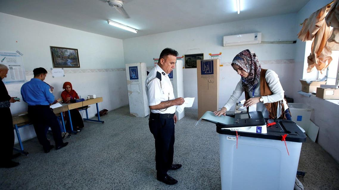 A Kurdish police officer casts his vote at a polling station two days before polls open to the public in a parliamentary election in Erbil, Iraq, on May 10, 2018. (Reuters)