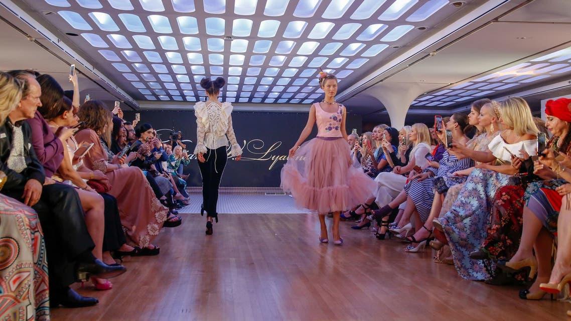 A model walks on the catwalk displaying creations by Russian designer Tatiana V. Lyalina during Arab Fashion Week in Dubai on May 9, 2018. (AFP)