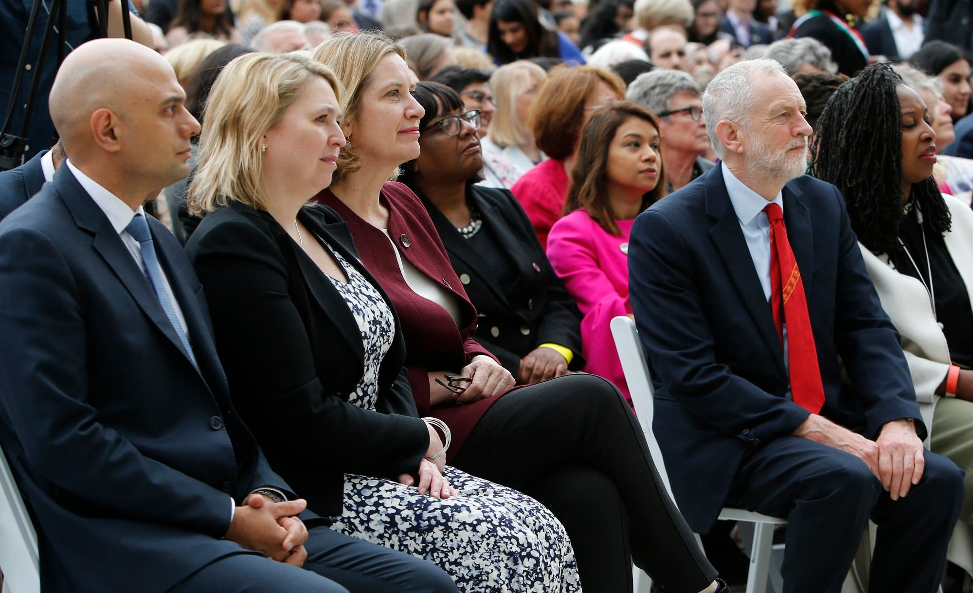 Sajid Javid left, with Karen Bradley Secretary of State for Northern Ireland, Amber Rudd the then Home Secretary, Labor MP Diane Abbott, Labor Party leader Jeremy Corbyn, second right and Labor MP Dawn Butler, right, watch the unveiling a statue of Millicent Fawcettin Parliament Square, London on April 24, 2018. (AP)
