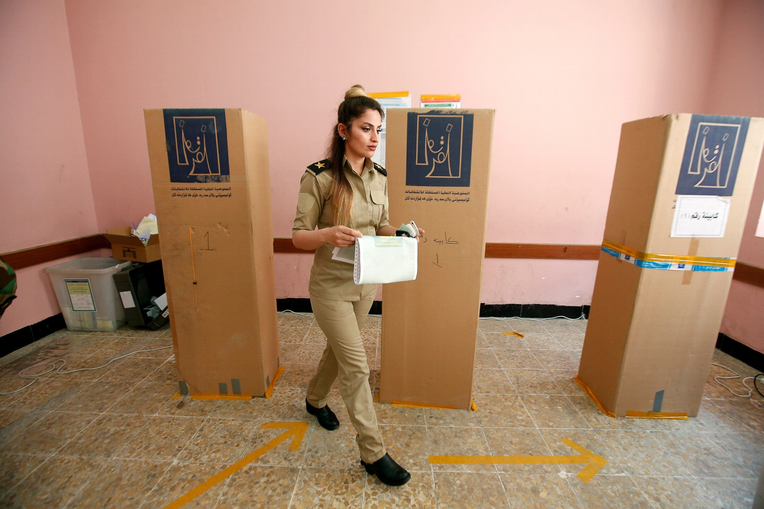 A member of Kurdish peshmerga casts her vote in Erbil on May 10, 2018. (Reuters)