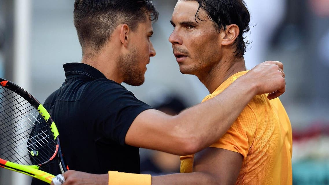 Rafael Nadal congratulates Dominic Thiem (L) after their ATP Madrid Open quarter-final tennis match at the Caja Magica in Madrid on May 11, 2018. (AFP)