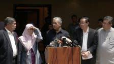 A royal pardon expected for Anwar, Mahathir foe-turned ally