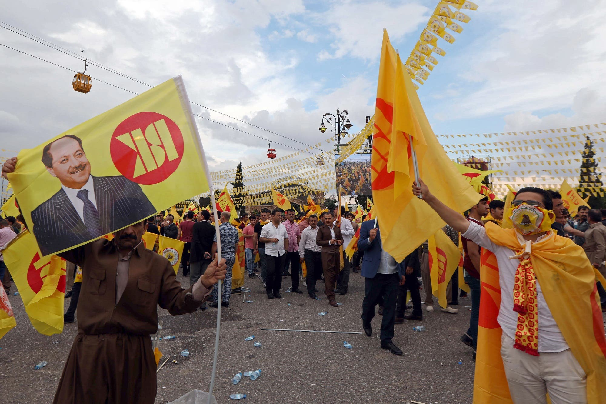 Iraqi Kurds wave flags as they attend an electoral rally for the Kurdistan Democratic Party (KDP) in Erbil on May 10, 2018. (AFP)