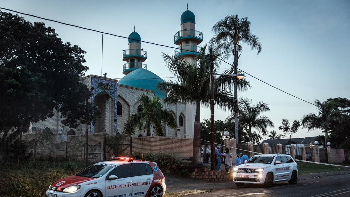 Police and emergency vehicles stand at the entrance to the Imam Hussain Mosque on the outskirts of Durban on May 10, 2018, after an attack which left one person dead and two injured. Armed attackers struck a mosque outside the South African city of Durban, stabbing to death an imam and injuring two others in a country known for its peaceful religious relations. Three men entered the large mosque after midday prayers, carrying guns and attacking the victims with knives and then releasing a petrol bomb that set fire to the building. (AFP)