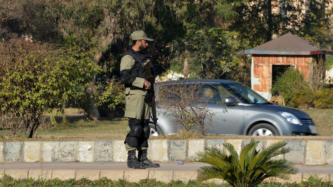 A Pakistani ranger stands guard on a street in Islamabad on January 2, 2014. (AFP)