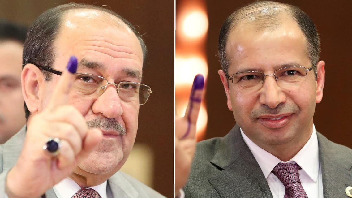 President of the Iraqi Parliament, Salim al-Jubouri (R) also issued a similar warning after casting his vote. (Reuters)