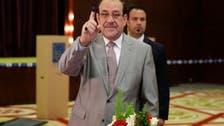 Former Iraqi PM Nouri al-Maliki casts vote at parliamentary elections