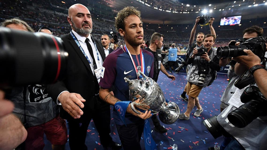 Neymar walks with the trophy at the end at the end of the French Cup final football match between Les Herbiers and PSG, on May 8, 2018 at the Stade de France in Saint-Denis, outside Paris. (AFP)
