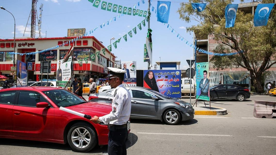 Banners and flags for candidates and lists for the elections hang along a street in the oil-rich and multi-ethnic northern city of Kirkuk. (AFP)