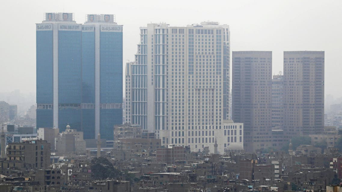 National Bank of Egypt head offices, the St. Regis Cairo hotel and Hilton Cairo World Trade Center Residences are seen towering above residential buildings in the downtown Cairo, Egypt, May 6, 2018. (Reuters)