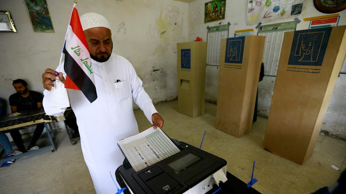 An Iraqi man casts his vote at a polling station during the parliamentary election in Baghdad, Iraq May 12, 2018. REUTERS/Thaier al-Sudani