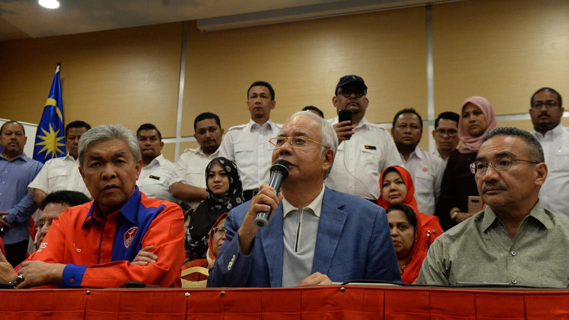 Former Malaysian prime minister Najib Razak (C) attends a press conference announcing his resignation as president of the United Malays National Organisation (UMNO), the main component party of the defeated Barisan Nasional (BN) coalition, in Kuala Lumpur on May 12, 2018. Malaysia's defeated leader Najib Razak on May 12 announced he was quitting as head of the Barisan Nasional coalition and its main party after leading the coalition to a shock loss.