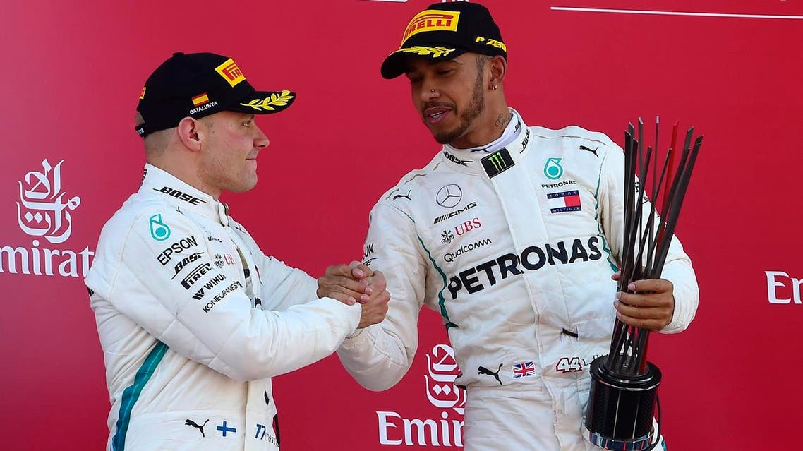 Lewis Hamilton (right) celebrates on the podium with second placed Valtteri Bottas after winning the Spanish Formula One Grand Prix at the Circuit de Catalunya in Montmelo in the outskirts of Barcelona on May 13, 2018. (AFP)