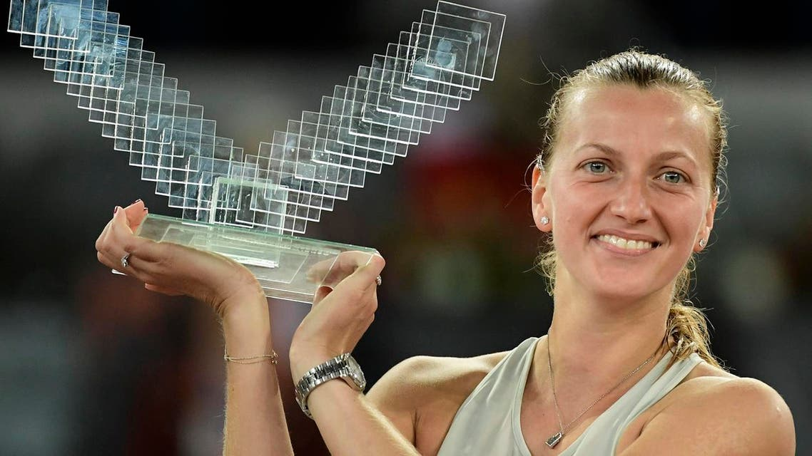 Czech Republic's Petra Kvitova holds her first place trophy after defeating Netherlands' Kiki Bertens during their WTA Madrid Open final tennis match at the Caja Magica in Madrid on May 12, 2018. (AFP)