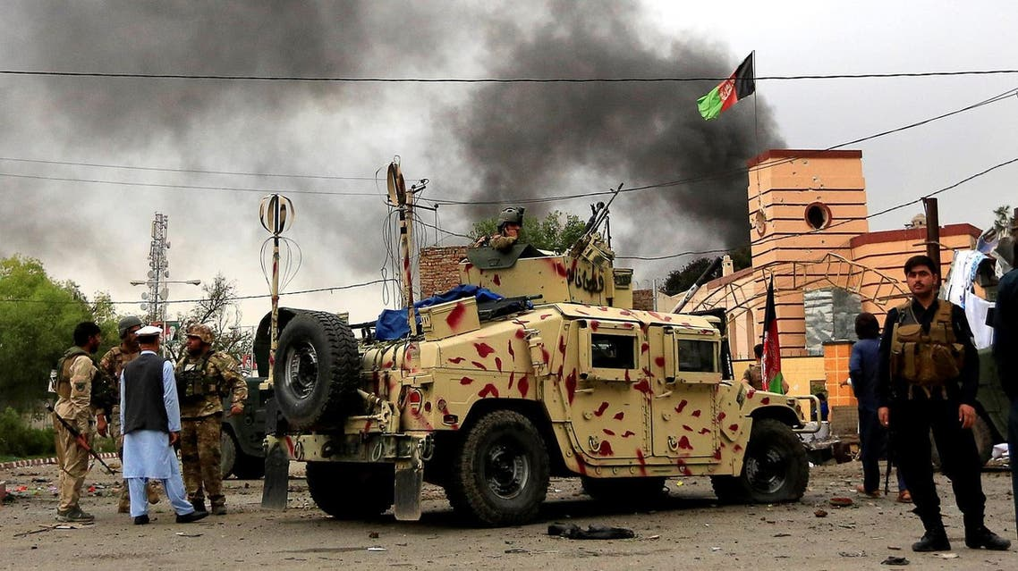 Afghan security forces keep watch during blasts and gunbattle at the site in Jalalabad city, Afghanistan, on May 13, 2018. (Reuters)