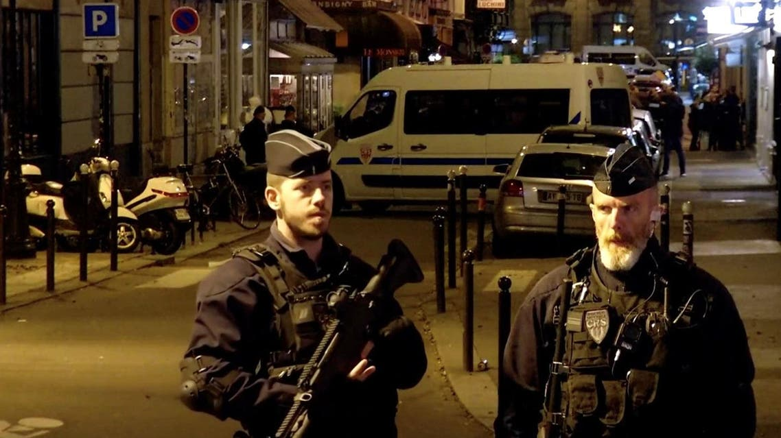 Police guard the scene of a knife attack in Paris, on May 12, 2018 in this still image obtained from a video. (Reuters)