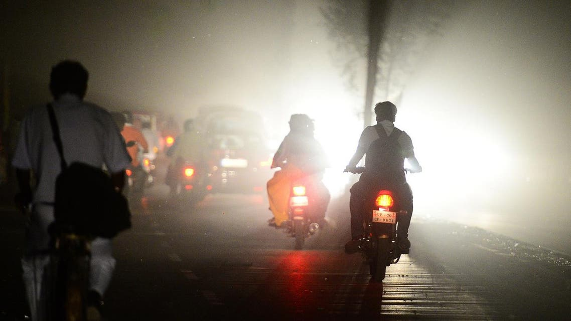 People dive scooters during a dust storm in Allahabad on May 13, 2018. (AFP)