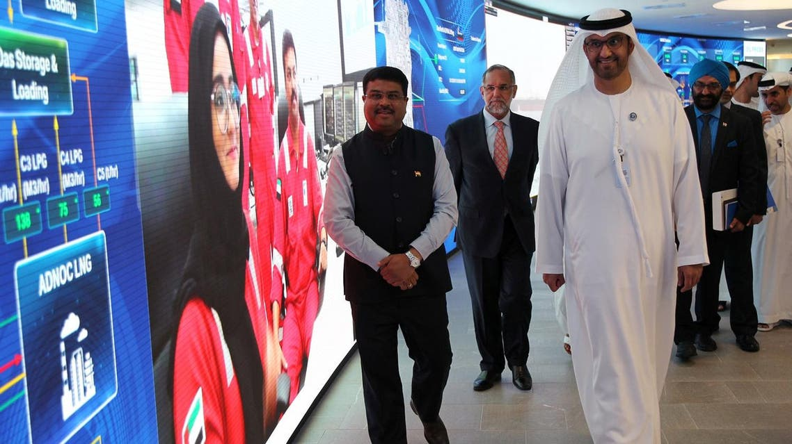 Indian Oil Minister Dharmendra Pradhan (L) and Dr Sultan Ahmed Al Jaber, UAE Minister of State and ADNOC Group CEO tour the Panorama Digital Command Centre at the ADNOC headquarters in Abu Dhabi, UAE, on May 12, 2018. (Reuters)