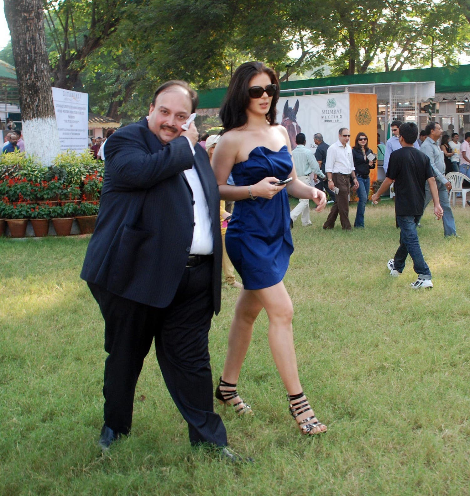 Bollywood actress Urvashi Sharma (R) and businessman Mehul Choksi (L) at a fashion show in Mumbai on December 13, 2009. (AFP)