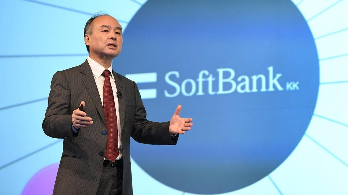 SoftBank Group Corp Chairman and CEO Masayoshi Son gestures as he delivers a speech during a press briefing. (AFP)