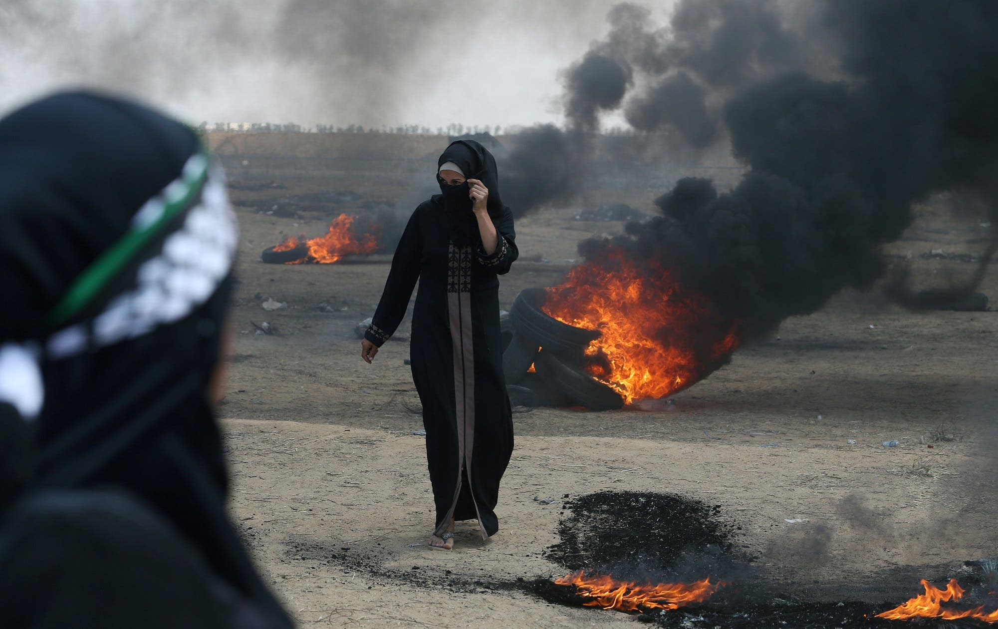 Female Palestinian demonstrator walks during a protest against US embassy move to Jerusalem. (Reuters)
