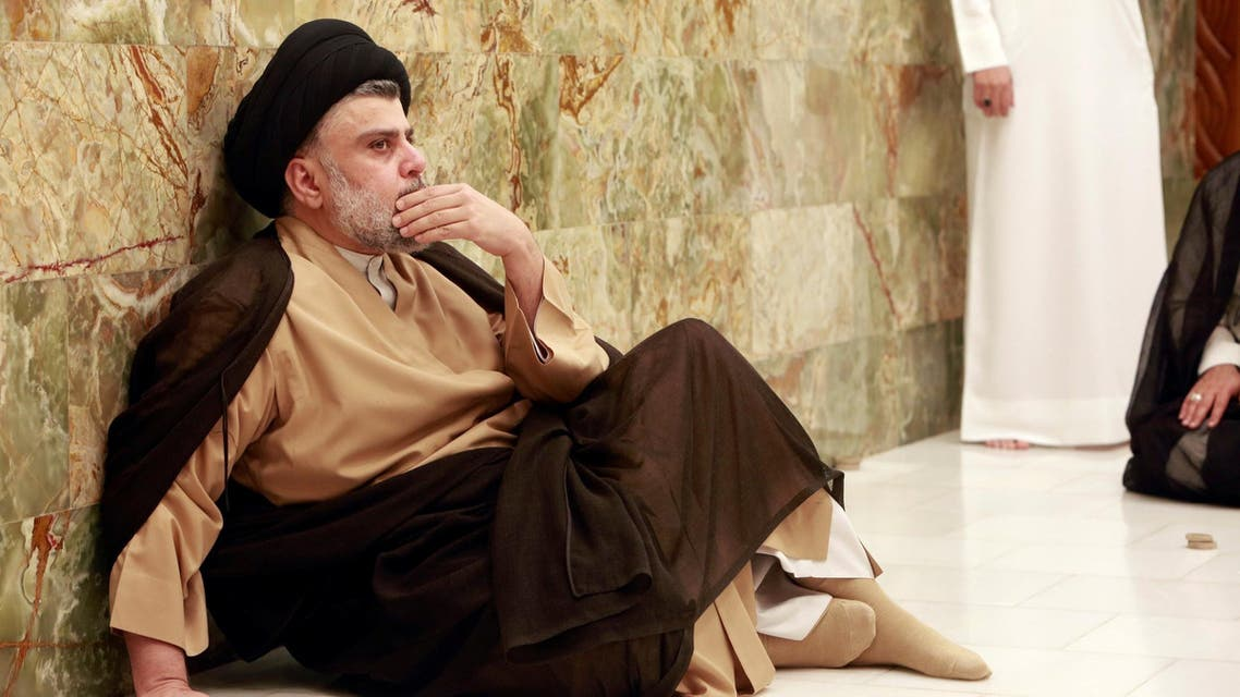 Iraqi Shiite cleric Muqtada al-Sadr visits his father's grave after parliamentary election results were announced, in Najaf, Iraq May 14, 2018. (Reuters)