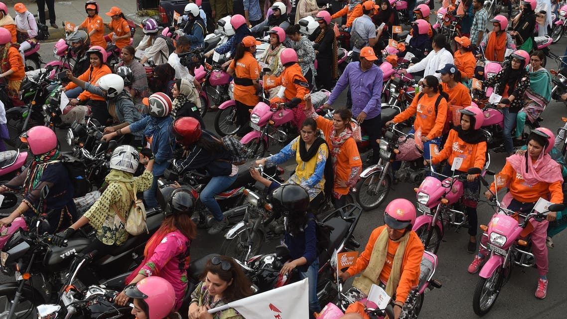 Pakistani women ride pink motorcycles during the rally in Lahore on May 13, 2018. (AFP)