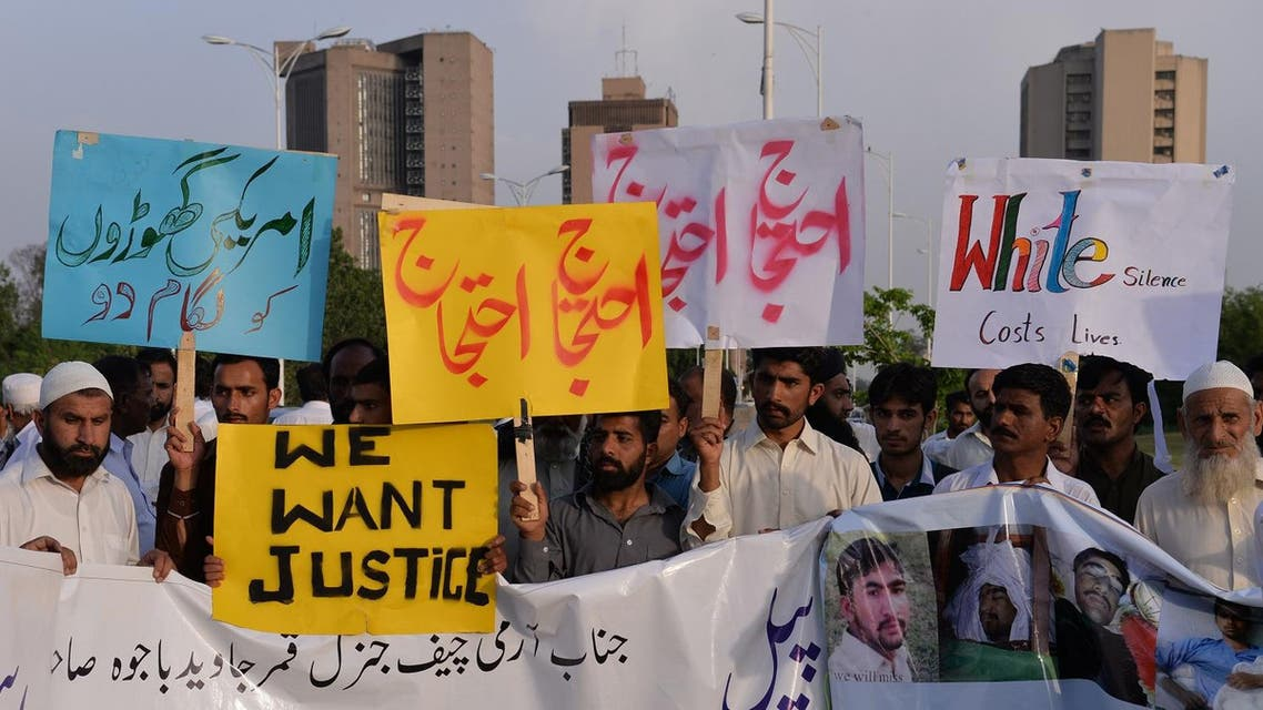 Pakistani protesters carry placards during a demonstration against the killing of a local resident in a car accident involving a US diplomat in Islamabad on April 25, 2018. (AFP)