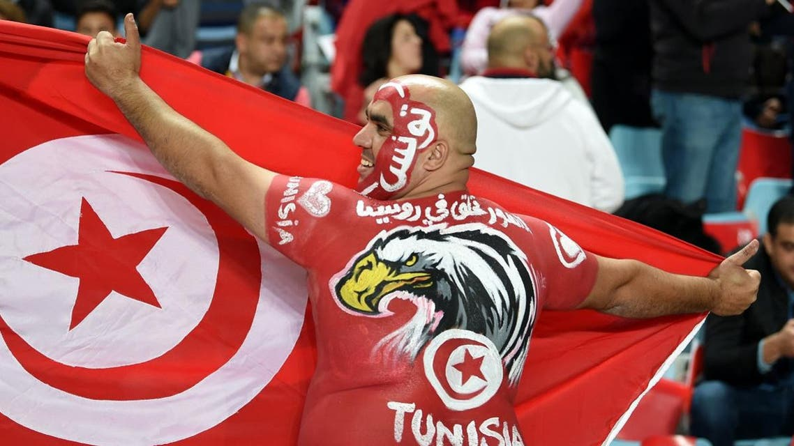 A Tunisian fan cheers for his national team ahead of the FIFA World Cup qualification football match between between Tunisia and Libya. (Reuters)