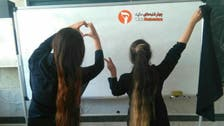 WATCH: Iranian girls react to teacher's punishment of student with long hair