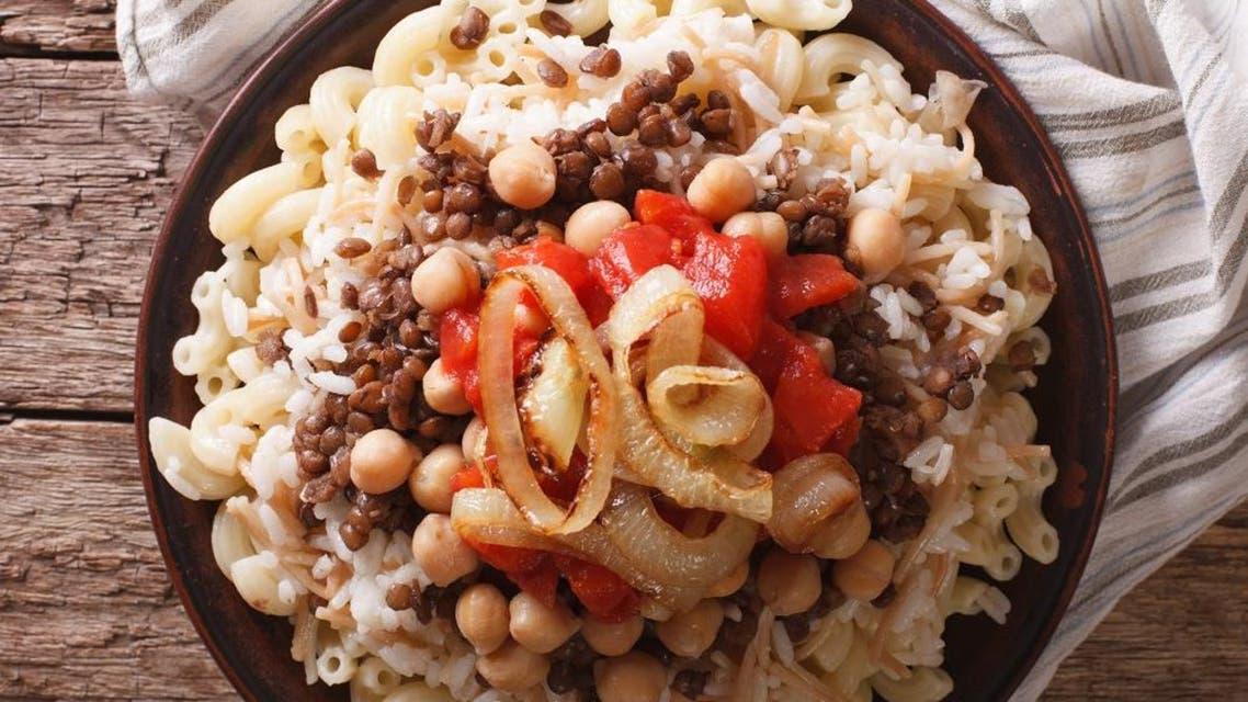 Koshari – a hearty, carb-rich dish, mainly consisting of rice, pasta, chickpeas and lentils. (Shutterstock)