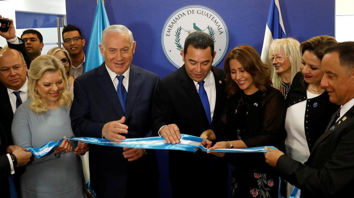 Hilda Patricia Marroquin, the wife of Guatemalan President Jimmy Morales, cuts the ribbon during the dedication ceremony of the embassy of Guatemala in Jerusalem. (Reuters)