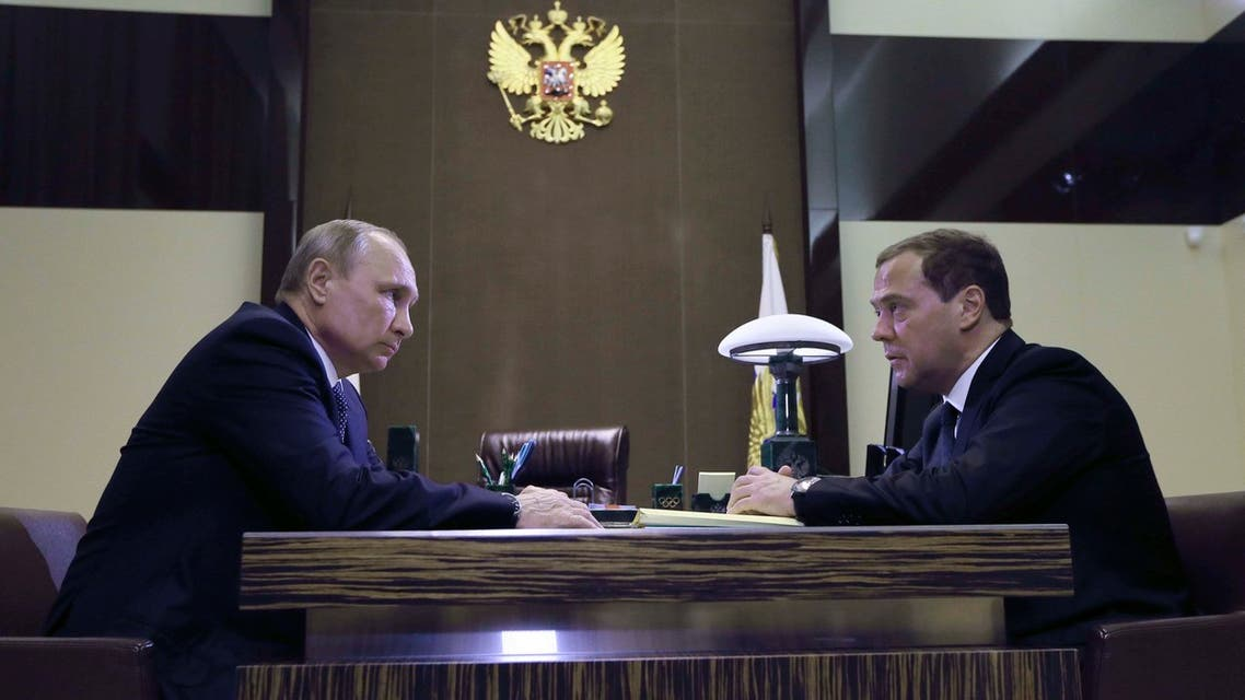 Russian President Vladimir Putin (L) meets with Prime Minister Dmitry Medvedev in Sochi, Russia May 15, 2018. Sputnik/Ekaterina Shtukina/Pool via REUTERS ATTENTION EDITORS - THIS IMAGE WAS PROVIDED BY A THIRD PARTY.