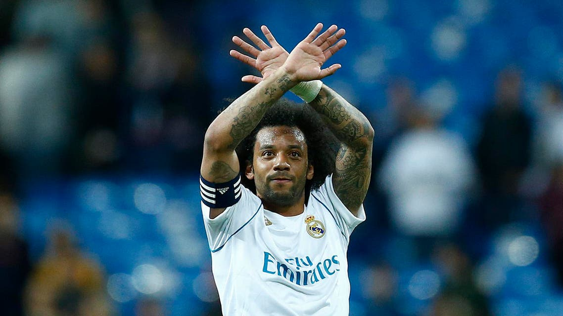 Real Madrid's Brazilian defender Marcelo gestures during the Spanish league football match between Real Madrid and Celta Vigo at the Santiago Bernabeu Stadium in Madrid on May 12, 2018. Benjamin CREMEL / AFP
