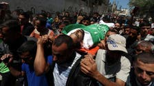 Israeli forces kill two Palestinians near border as Gaza buries dead