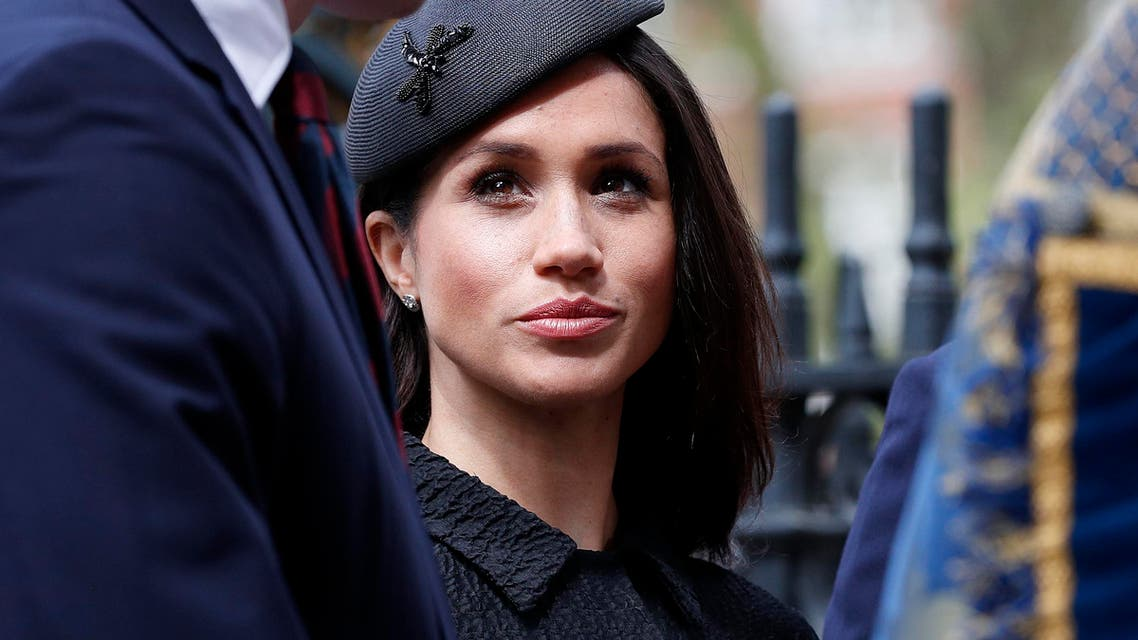 """(FILES) In this file photo taken on April 25, 2018 US fiancée of Britain's Prince Harry, Meghan Markle, talks with Britain's Prince William, Duke of Cambridge (L) as she arrives to attend a service of commemoration and thanksgiving to mark Anzac Day in Westminster Abbey in London. Thomas Markle, who has rocked Britain's royal family with a """"will he, won't he"""" drama over his attendance at daughter Meghan's wedding to Prince Harry, is a shy recluse, thrust into the limelight against his wishes. The 73-year-old initially said he was too unwell and embarrassed to walk his daughter down the aisle on Saturday, according to US celebrity news site TMZ, after allegedly staging photos of himself for money and suffering a heart attack amid the ensuing furor. (AFP)"""