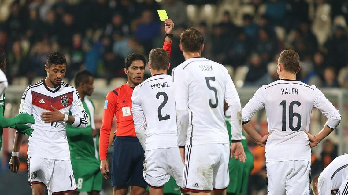 Referee Fahad Al Mirdasi of Saudi Arabia shows a yellow card to Germany's Grischa Proemel during the U20 soccer World Cup match. (AP)