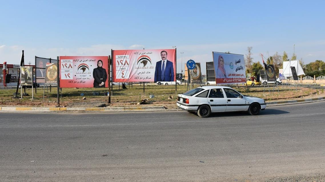 Campaign billboards for candidates in the parliamentary elections in Kirkuk. (AFP)