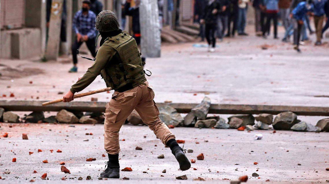 Demonstrators throw stones towards the Indian police during a protest against the recent killings in in Srinagar on May 8, 2018. (Reuters)