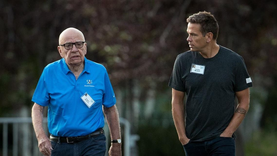 Rupert and Lachlan Murdoch walk together as they arrive on the third day of the annual Allen & Company Sun Valley Conference. (AFP)