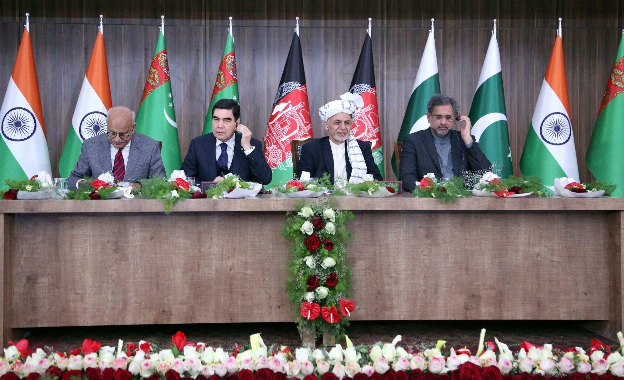 Afghanistan's President, Ashraf Ghani, third left, Turkimanistan president, Gubanguly Berdimuhamedow, second left, Pakistan Prime minister, Shahid Khaqan Abbasi, forth left, and Indian minister of state for external affairs, M. J. Akbar, first left, during the integration ceremony of TAPI pipeline in Herat on Feb. 23, 2018. (AP)