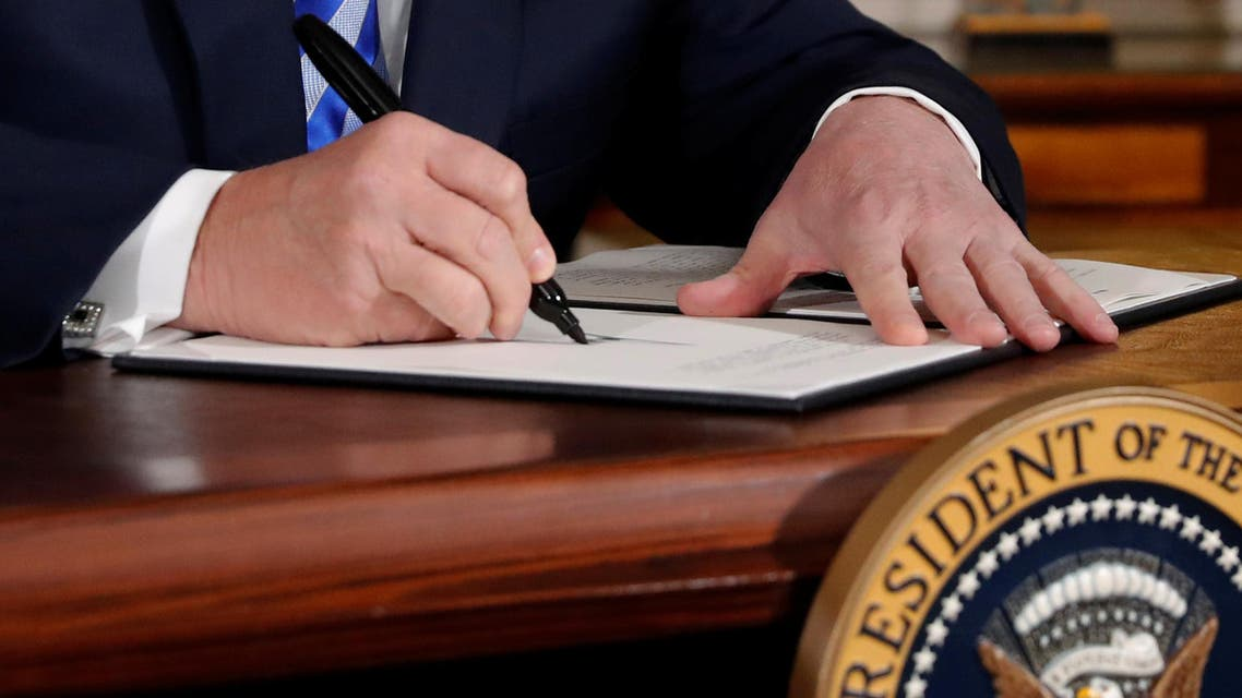 U.S. President Donald Trump signs a proclamation declaring his intention to withdraw from the JCPOA Iran...